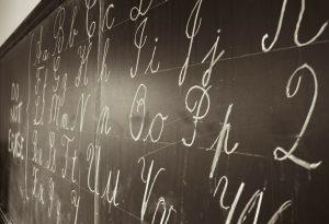 Cursive letters on blackboard.